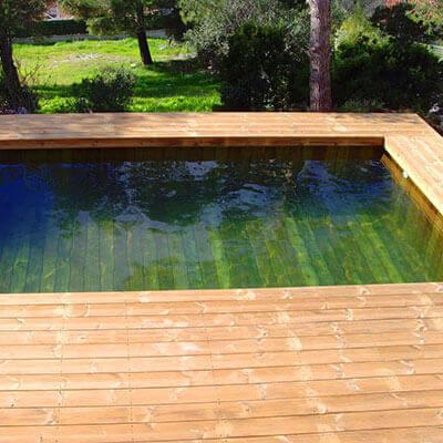 Photos de piscines en bois hors sol sur mesure sans liner for Combler une piscine