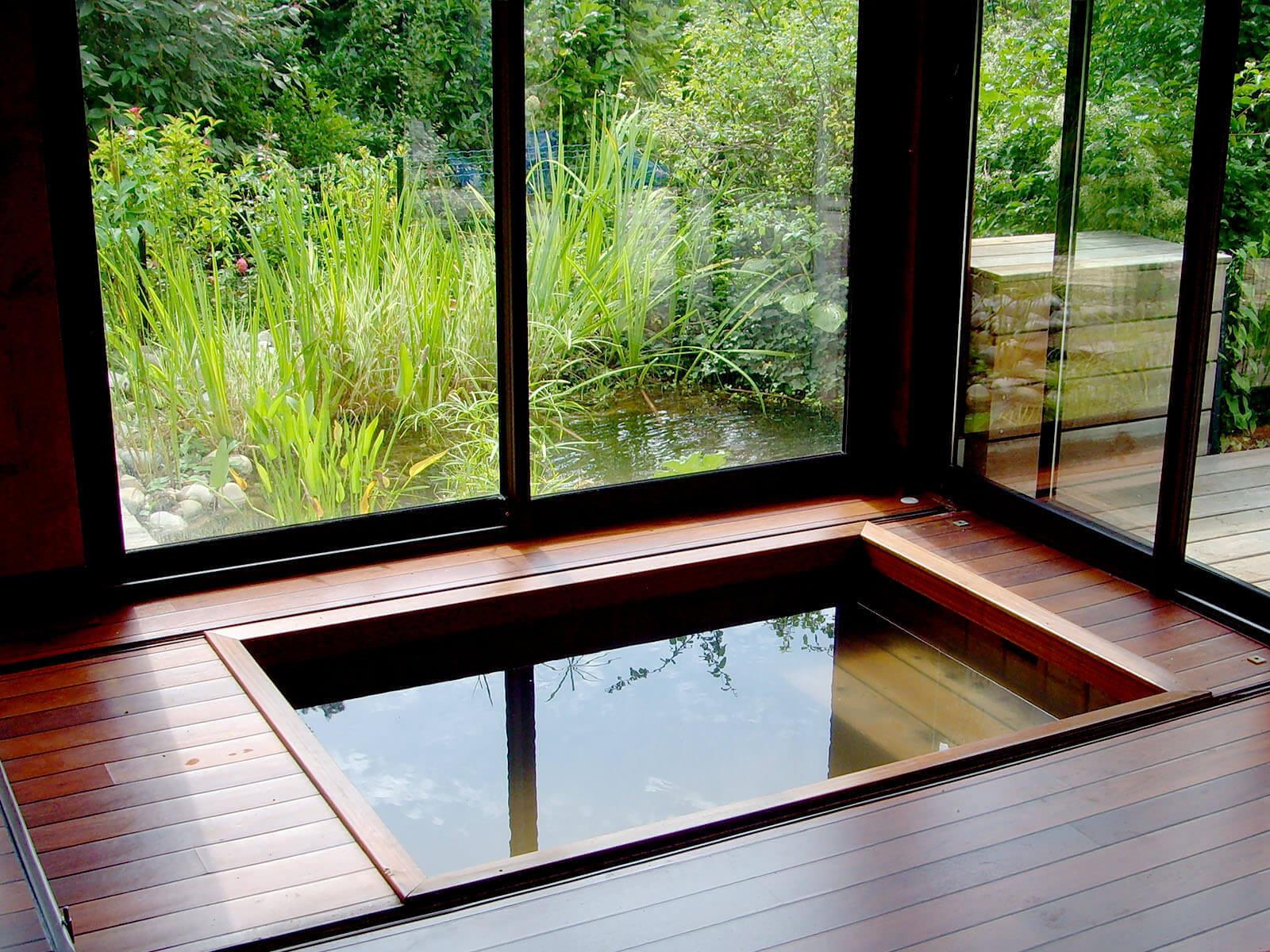 La plus belle r alisation de piscine int rieure en bois - Piscine dans le salon ...