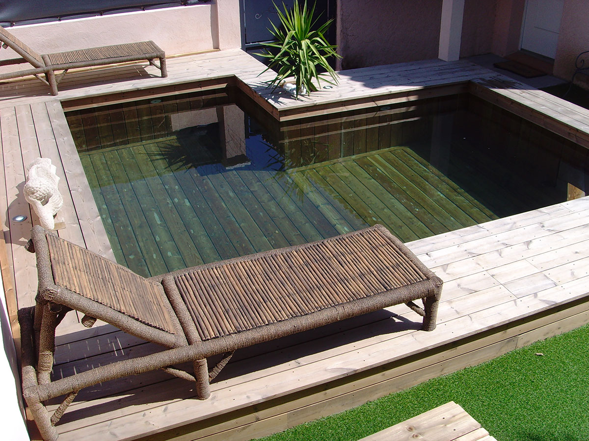 Piscine semi enterree bois fashion designs for Installateur piscine bois
