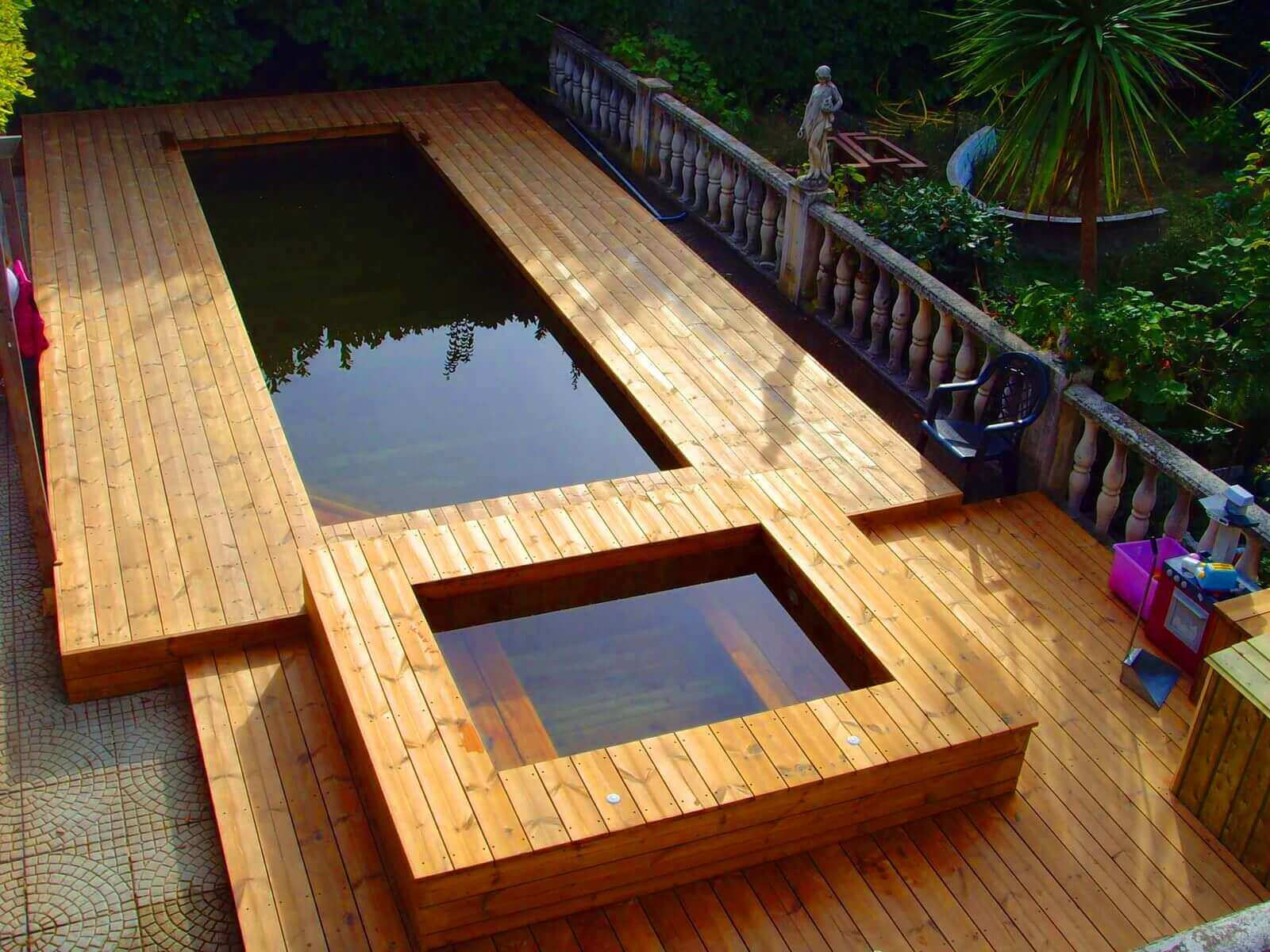 photos de poses de piscines semi enterr es en bois par odyssea. Black Bedroom Furniture Sets. Home Design Ideas