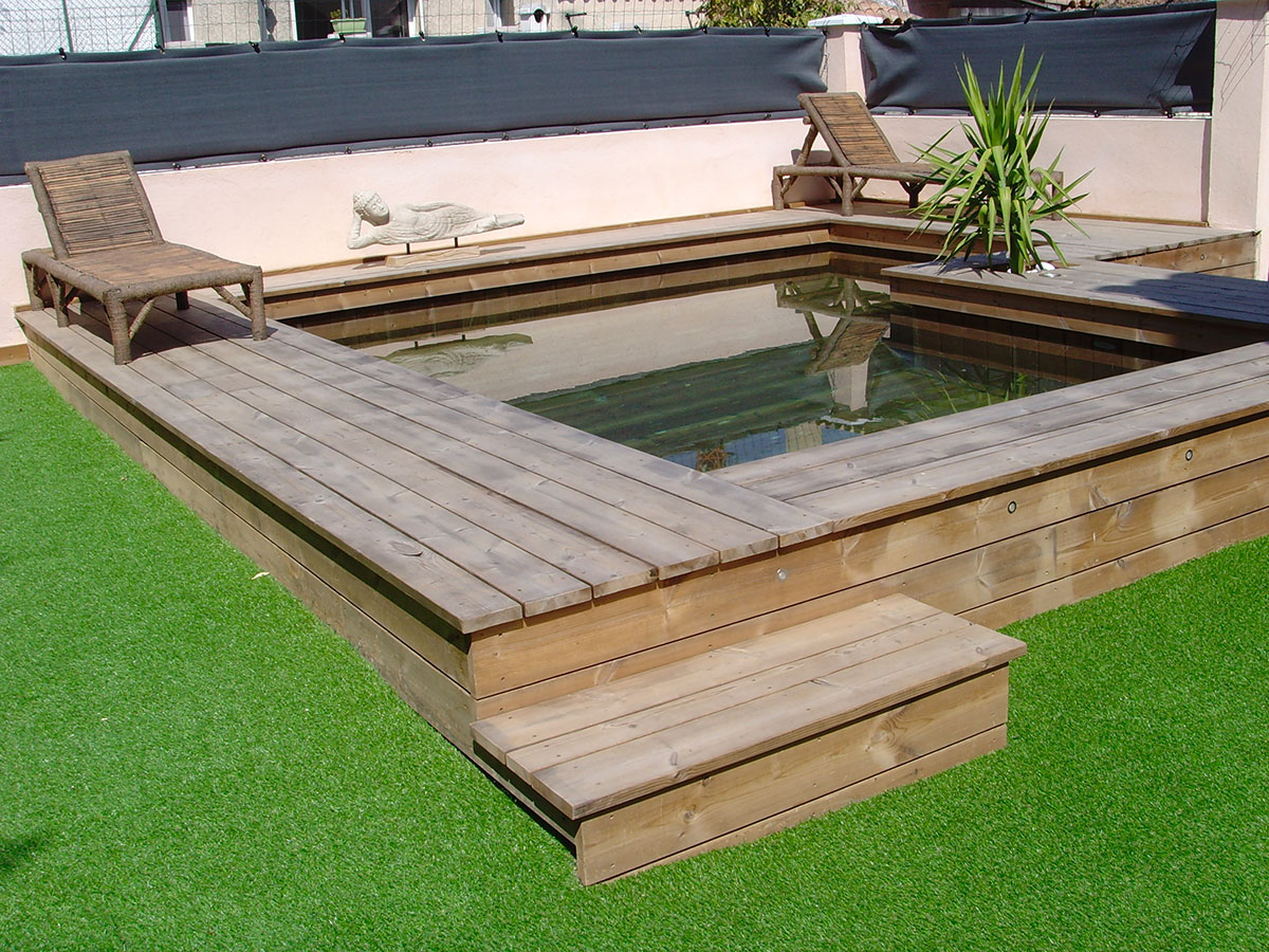 Photos de poses de piscines semi enterr es en bois par odyssea for Destockage piscine bois semi enterree