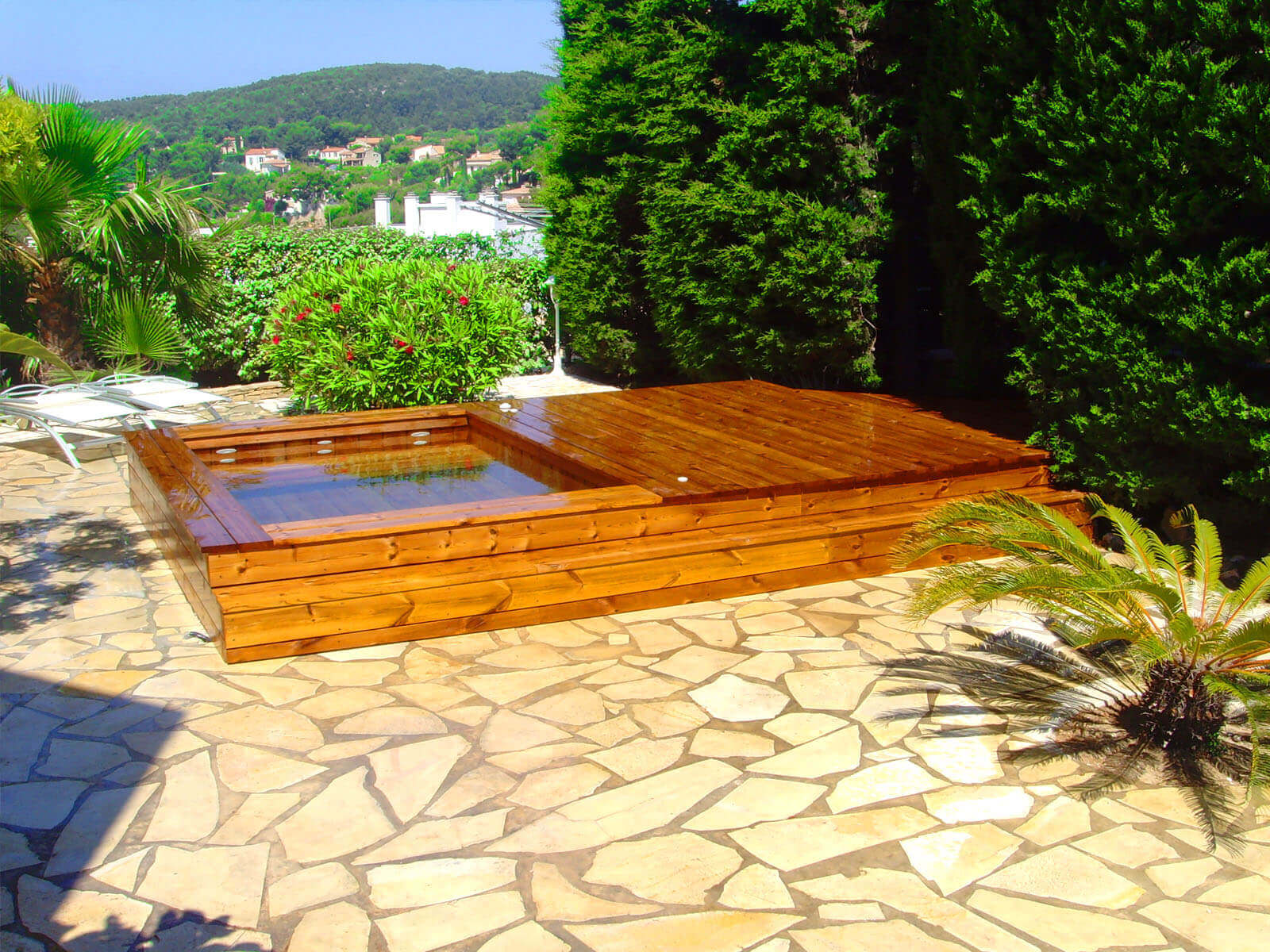Fabricant piscine et jacuzzi spa sur mesure 100 bois for Prix piscine terrasse